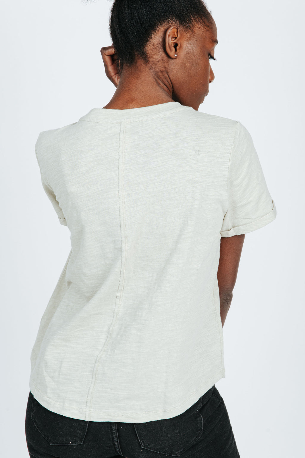 The Lindon Pocket Tee in Sage, studio shoot; back view