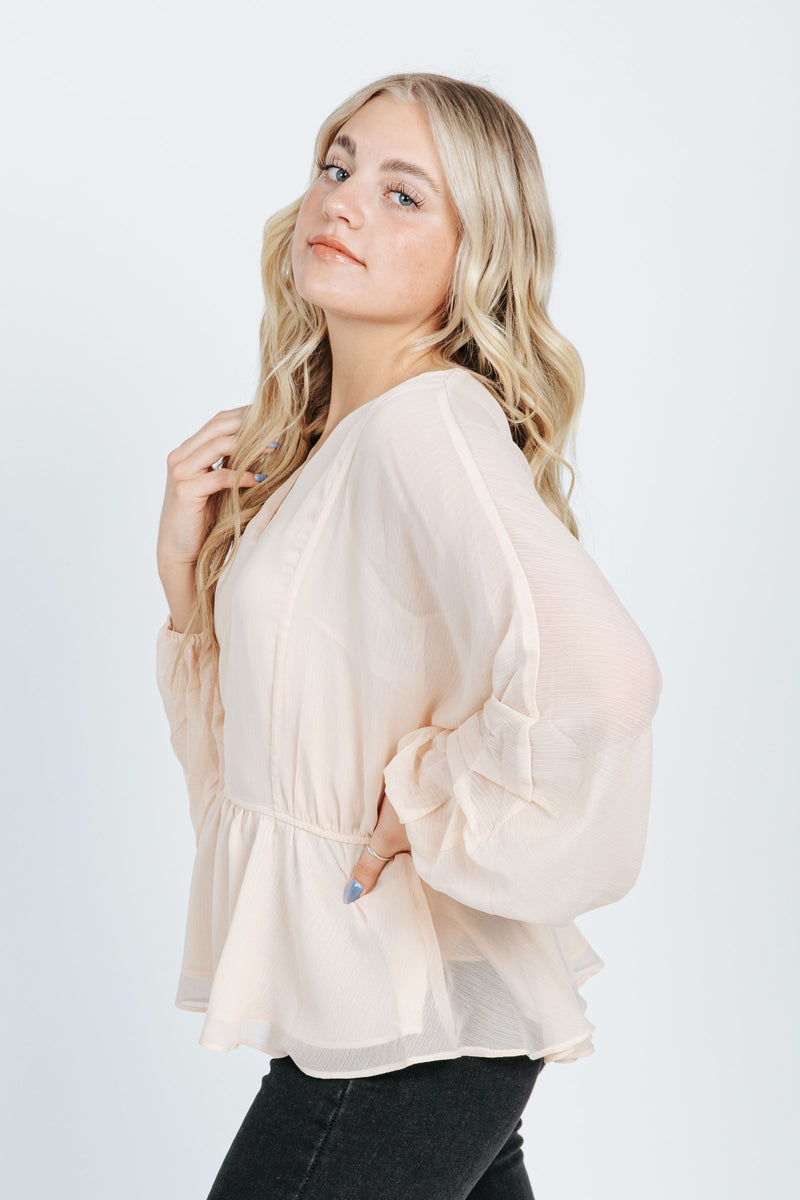 The Kane Balloon Sleeve Blouse in Champagne, studio shoot; side view