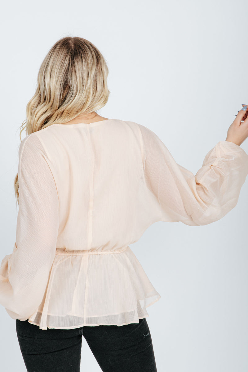 The Kane Balloon Sleeve Blouse in Champagne, studio shoot; back view