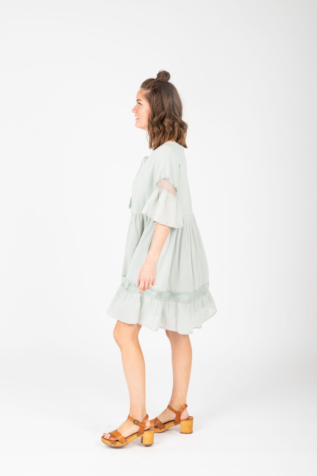 The Tinley Ruffle Detail Dress in Sage, studio shoot; side view