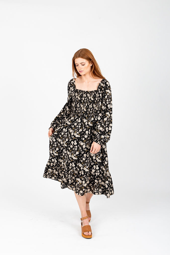 The Forsey Floral Smocked Midi Dress in Black, studio shoot; front view