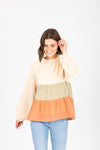 The Finley Tiered Peplum in Olive + Clay, studio shoot; front view