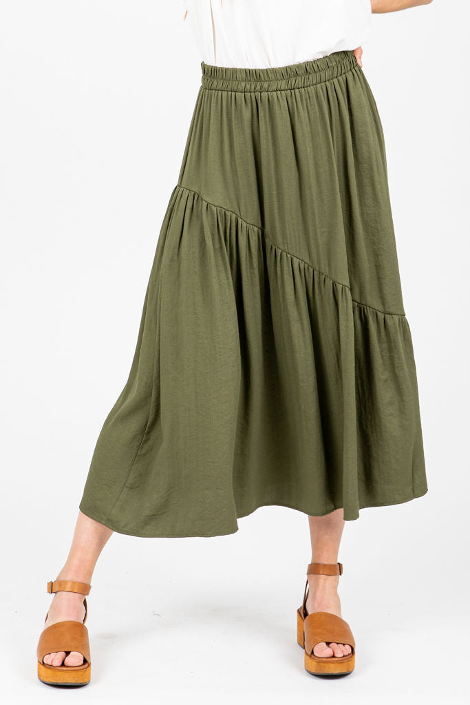 The Georgie A-Line Ruffle Skirt in Olive, studio shoot; front view