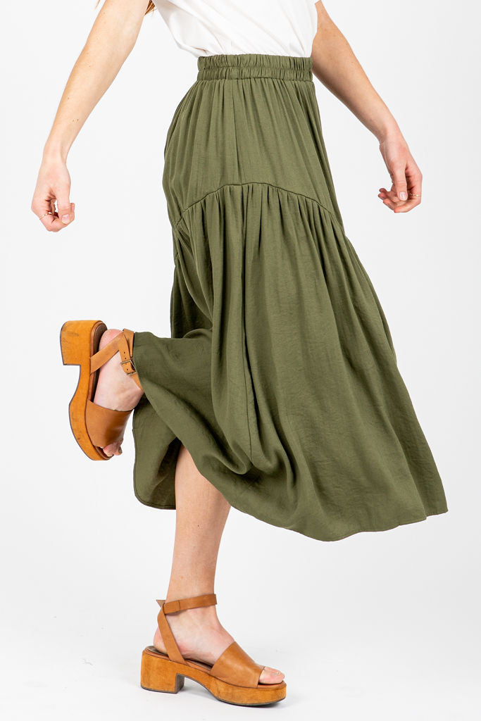 The Georgie A-Line Ruffle Skirt in Olive, studio shoot; side view