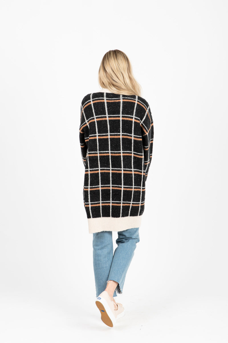 The Contact Plaid Cardigan in Black, studio shoot; back view