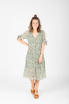 The Margo Floral Button Dress in Sage, studio shoot; front view