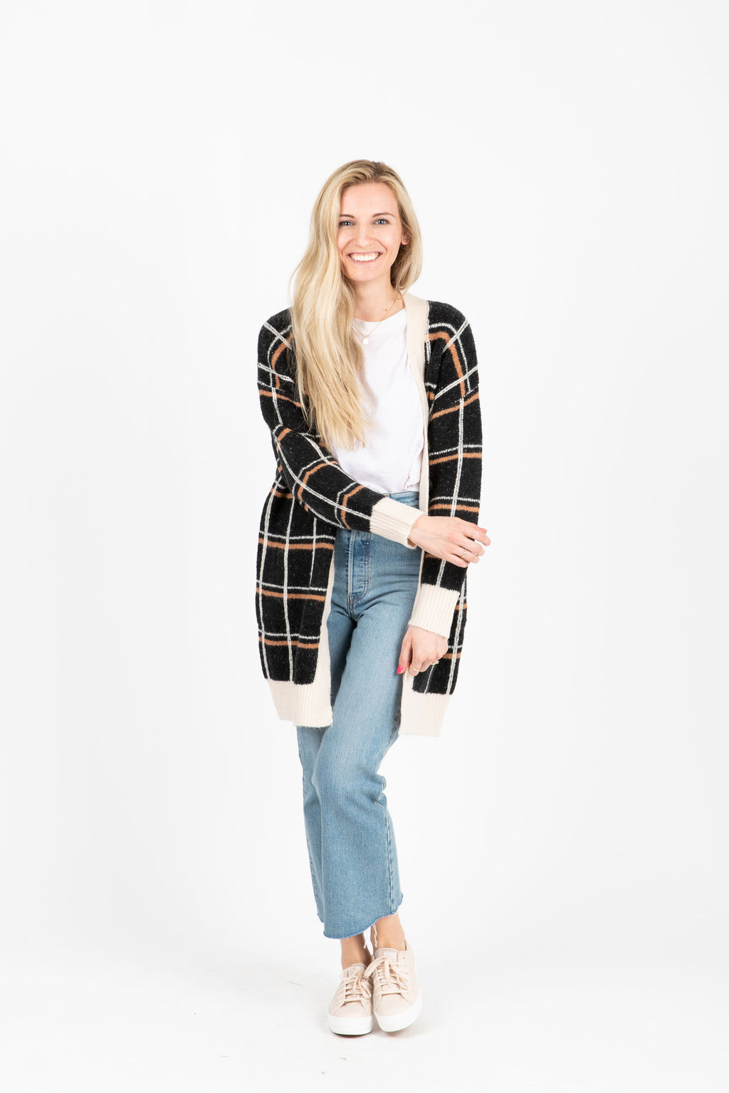 The Contact Plaid Cardigan in Black, studio shoot; front view