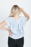 The Josiah Ruffle Blouse in Misty Blue, studio shoot; back view