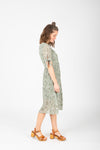 The Margo Floral Button Dress in Sage, studio shoot; side view