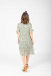 The Margo Floral Button Dress in Sage, studio shoot; back view