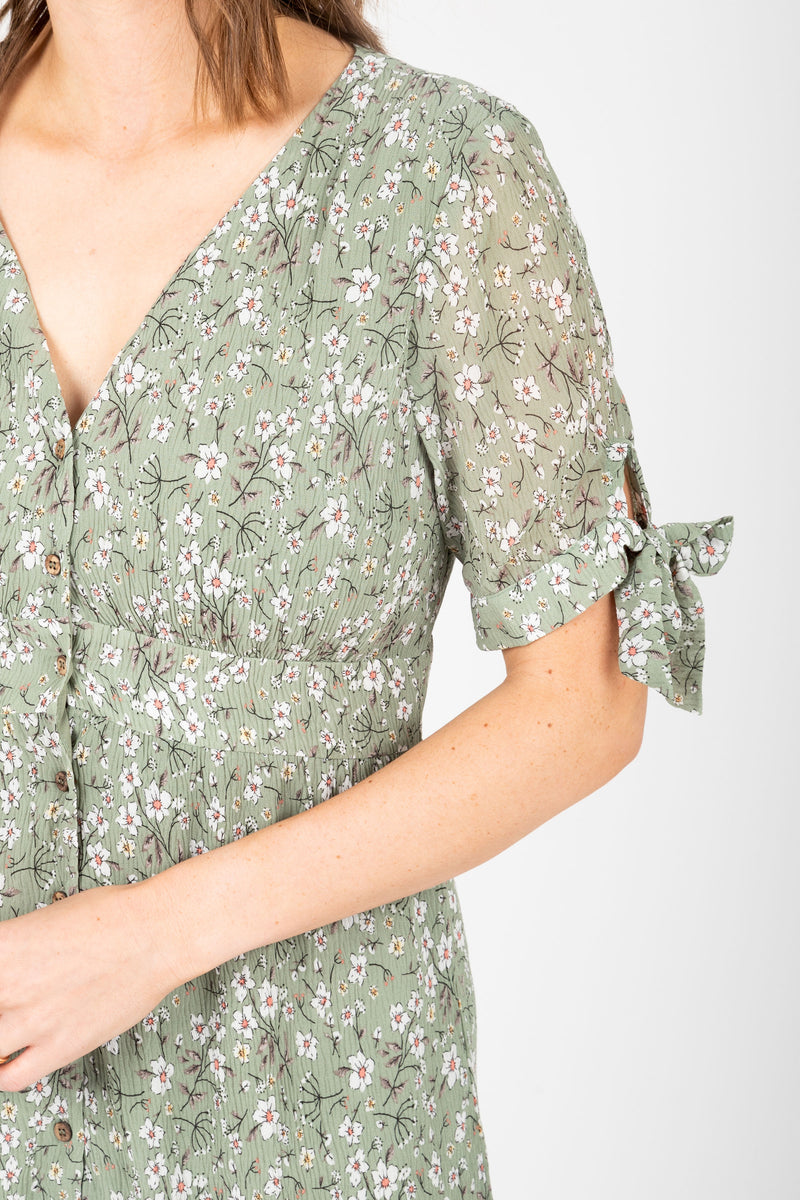 The Margo Floral Button Dress in Sage, studio shoot; closer up front view