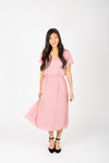 The Derby Dress in Blush, studio shoot; front view