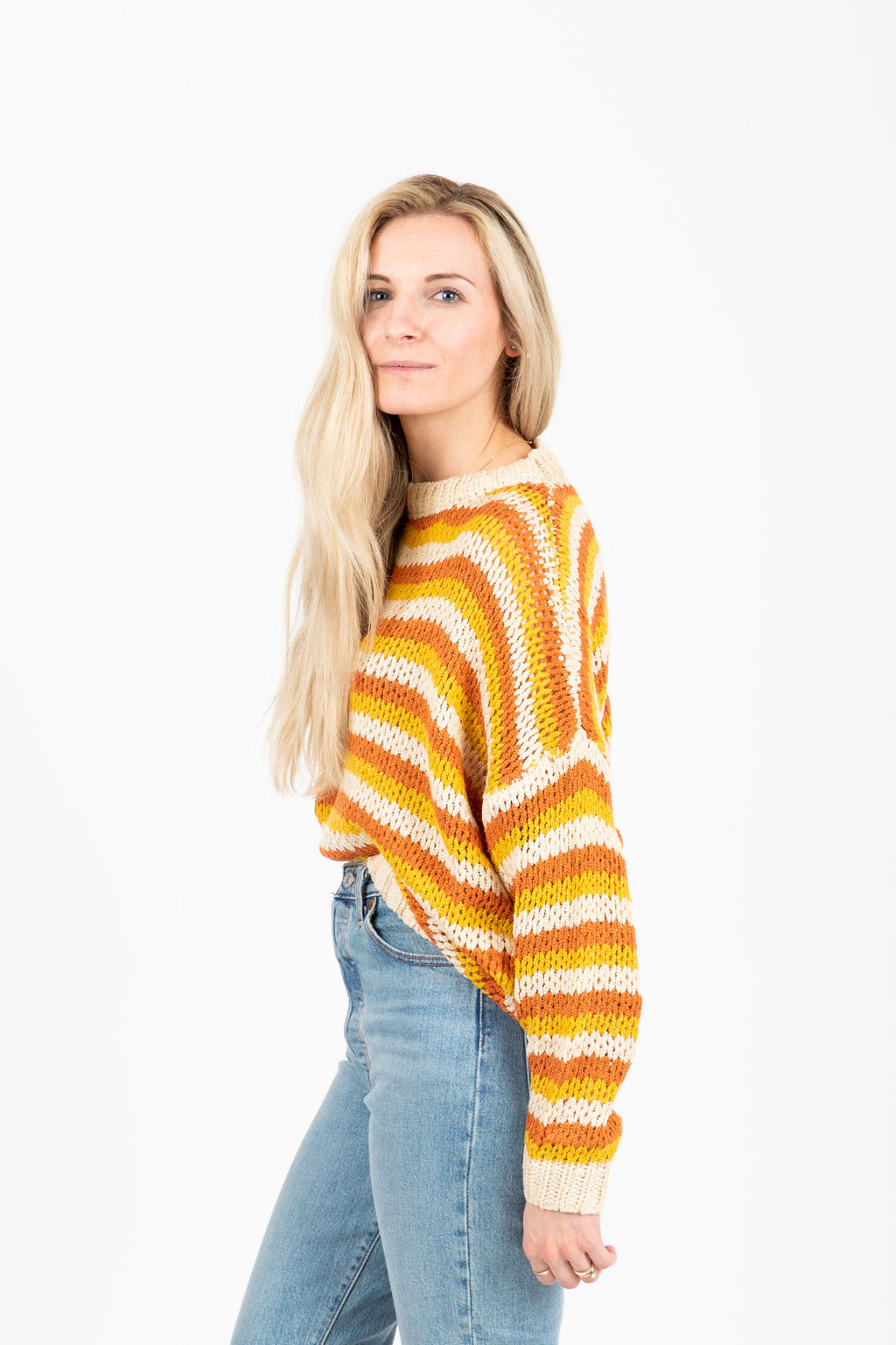 The Synapse Striped Sweater in Mustard- studio shoot; side view