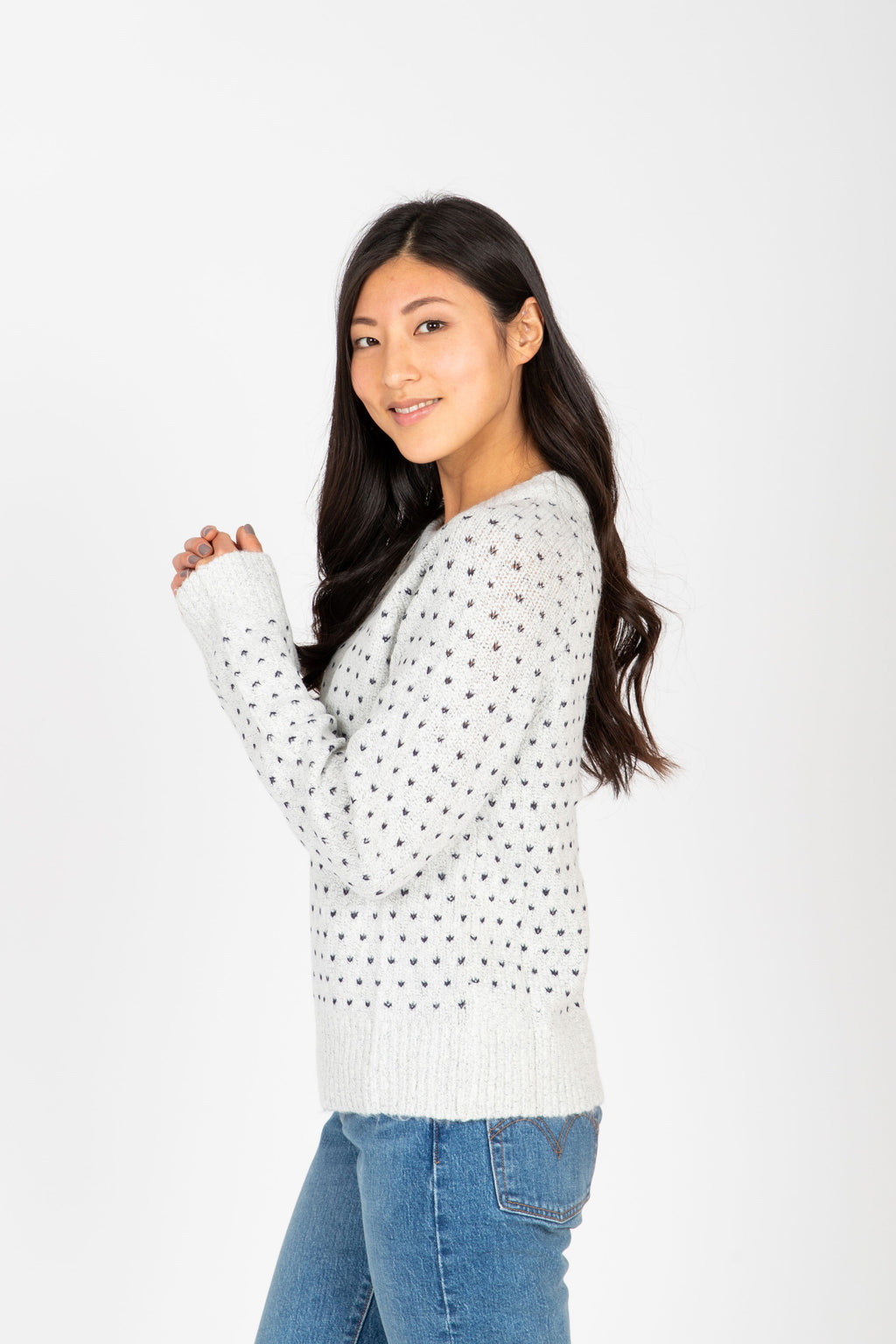 The Prime Heart Stitch Sweater in Ivory, studio shoot; side view