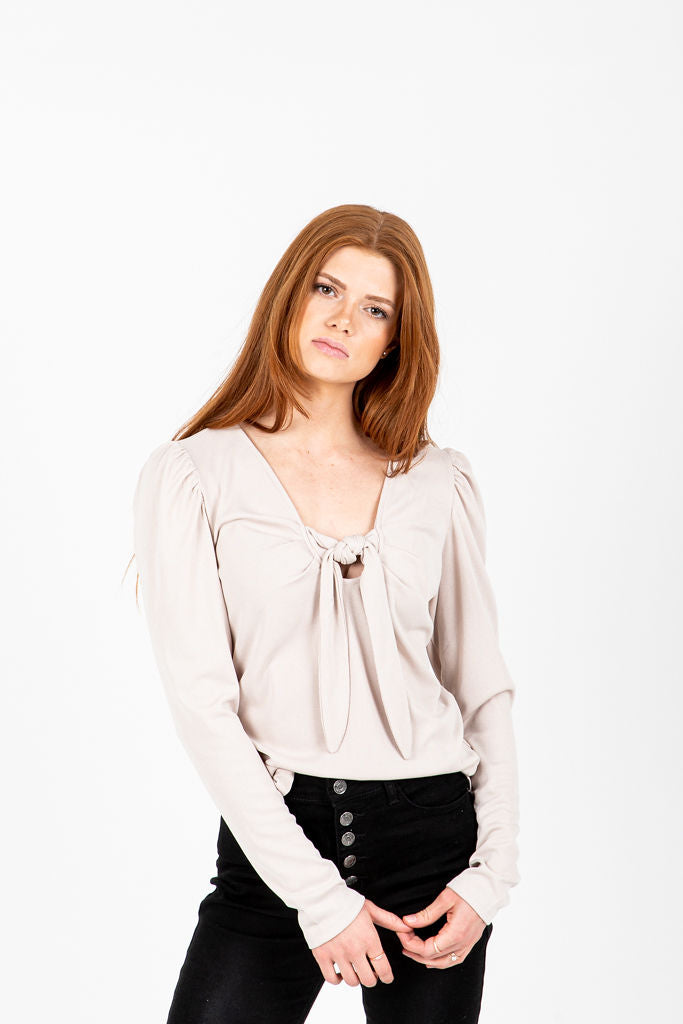 The Huntley Knotted Pairing Blouse in Cream, studio shoot; front view