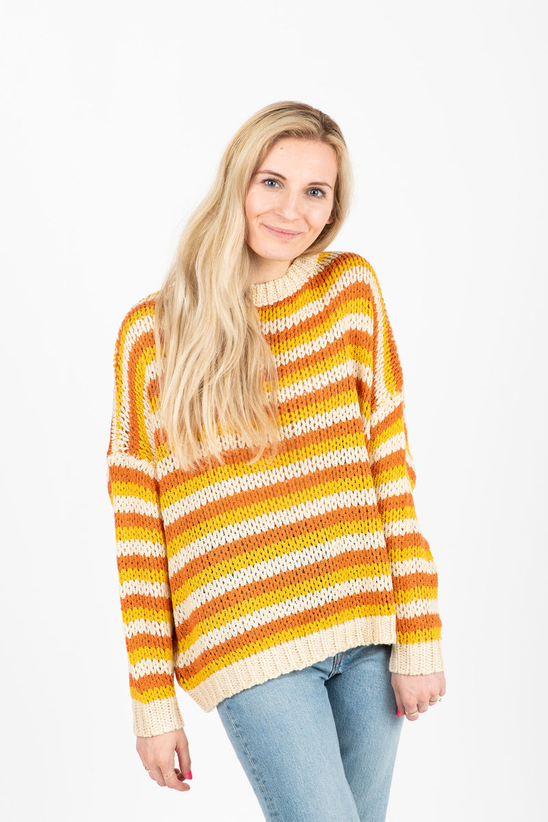 The Synapse Striped Sweater in Mustard- studio shoot; front view
