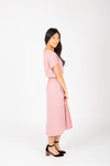 The Derby Dress in Blush, studio shoot; side view