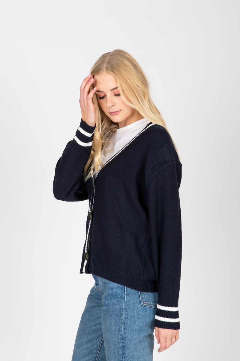 The Trace Prep Cardigan in Navy, studio shoot; side view