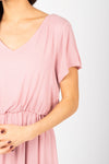 The Derby Dress in Blush, studio shoot; closer up front view