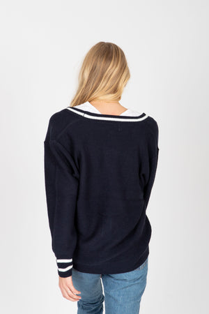 The Trace Prep Cardigan in Navy, studio shoot; back view