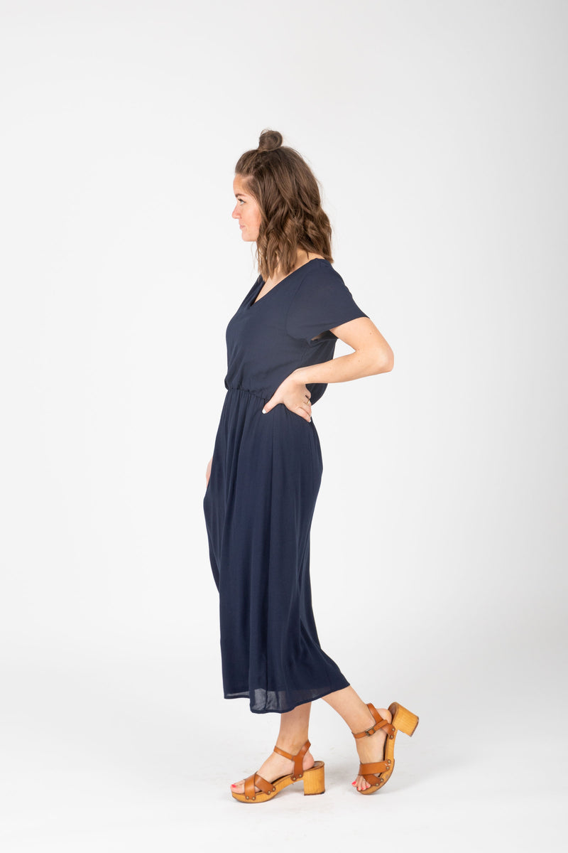 The Derby Dress in Navy, studio shoot; side view