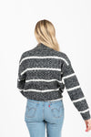The Her Striped Sweater in Heathered Charcoal- studio shoot; back view