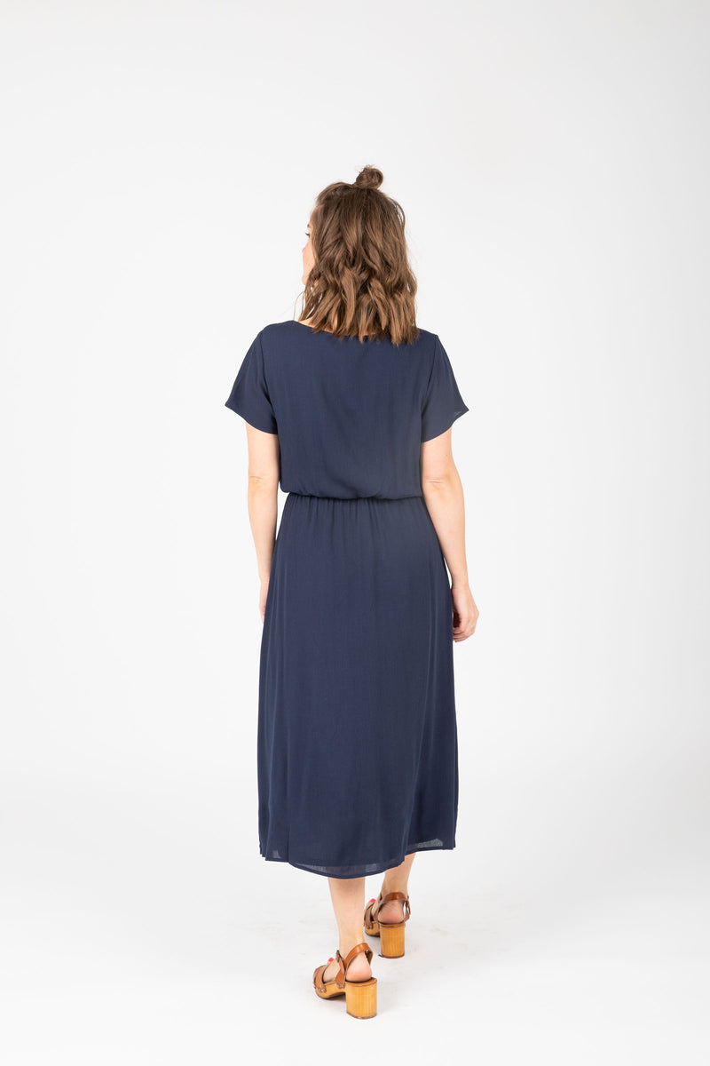The Derby Dress in Navy, studio shoot; back view