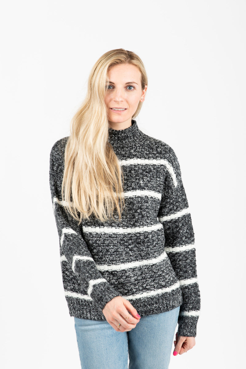 The Her Striped Sweater in Heathered Charcoal- studio shoot; front view