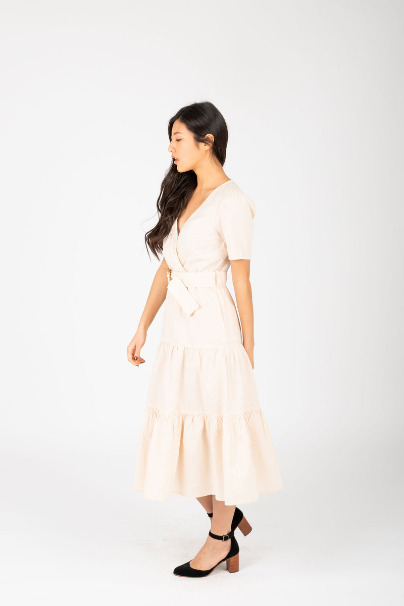 The Ann Tiered Belted Dress in Natural, studio shoot; side view