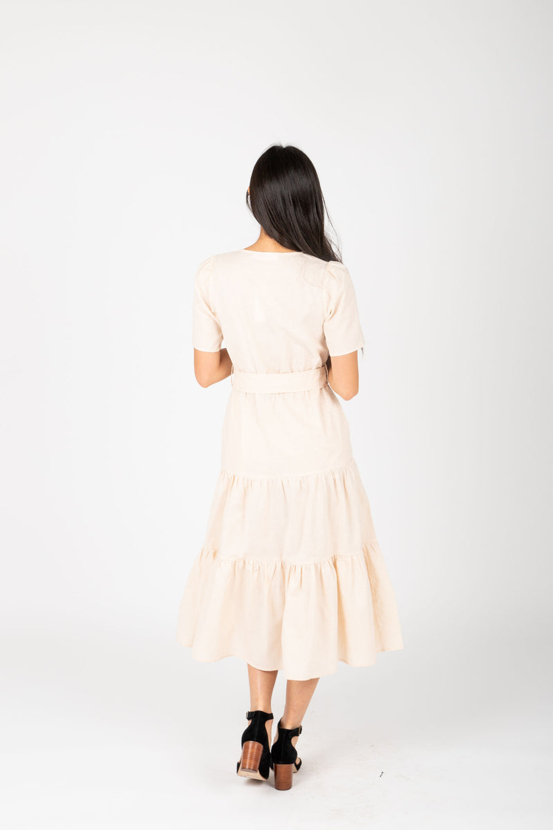 The Ann Tiered Belted Dress in Natural, studio shoot; back view