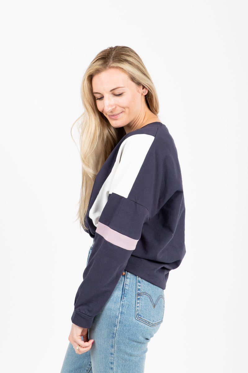 The Hubris Block Sweatshirt in Navy, studio shoot; side view