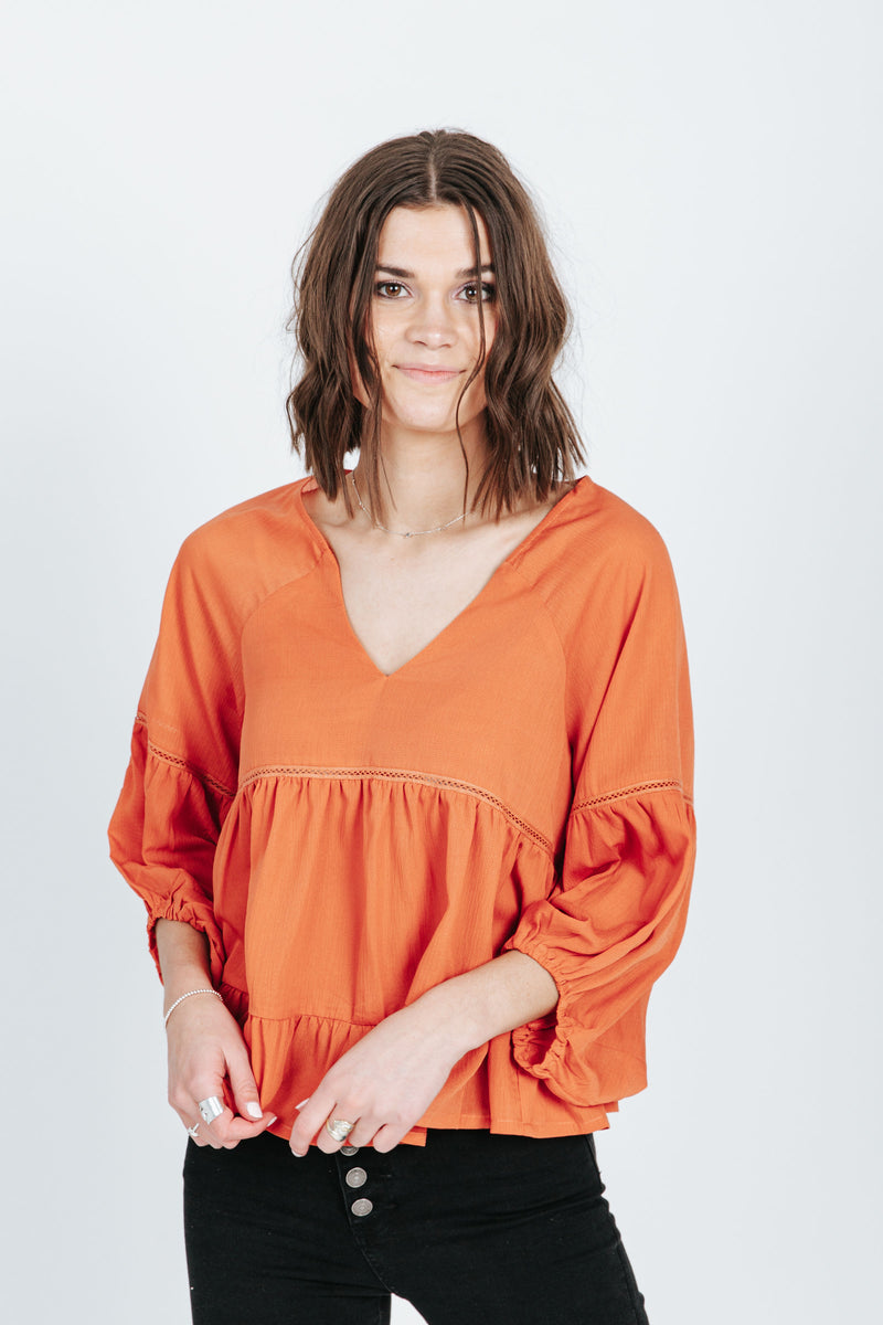 The Spence V-Neck Babydoll Blouse in Ginger, studio shoot; front view