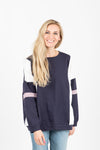 The Hubris Block Sweatshirt in Navy, studio shoot; front view