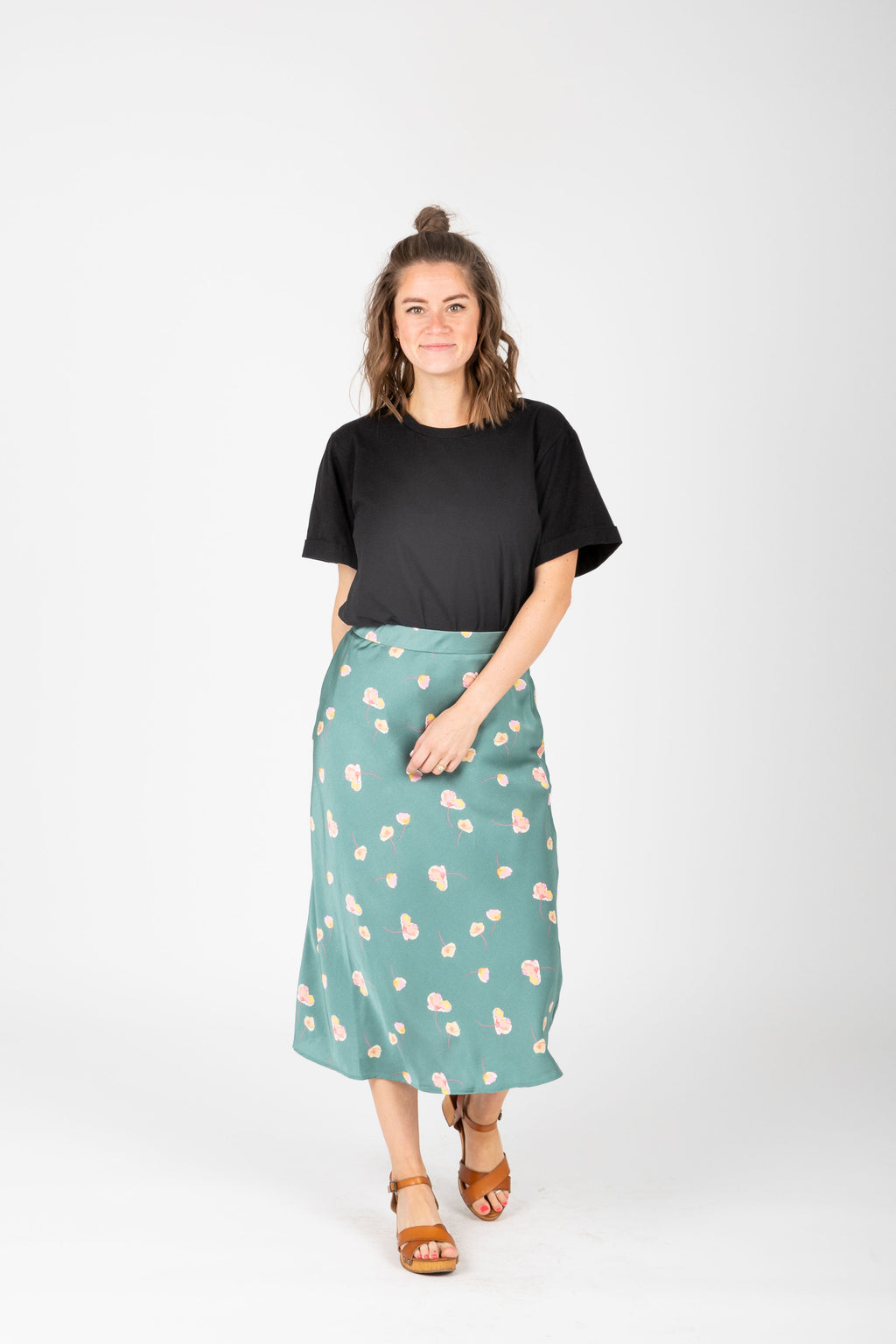 The Aiyana Floral Satin Skirt in Teal, studio shoot; front view