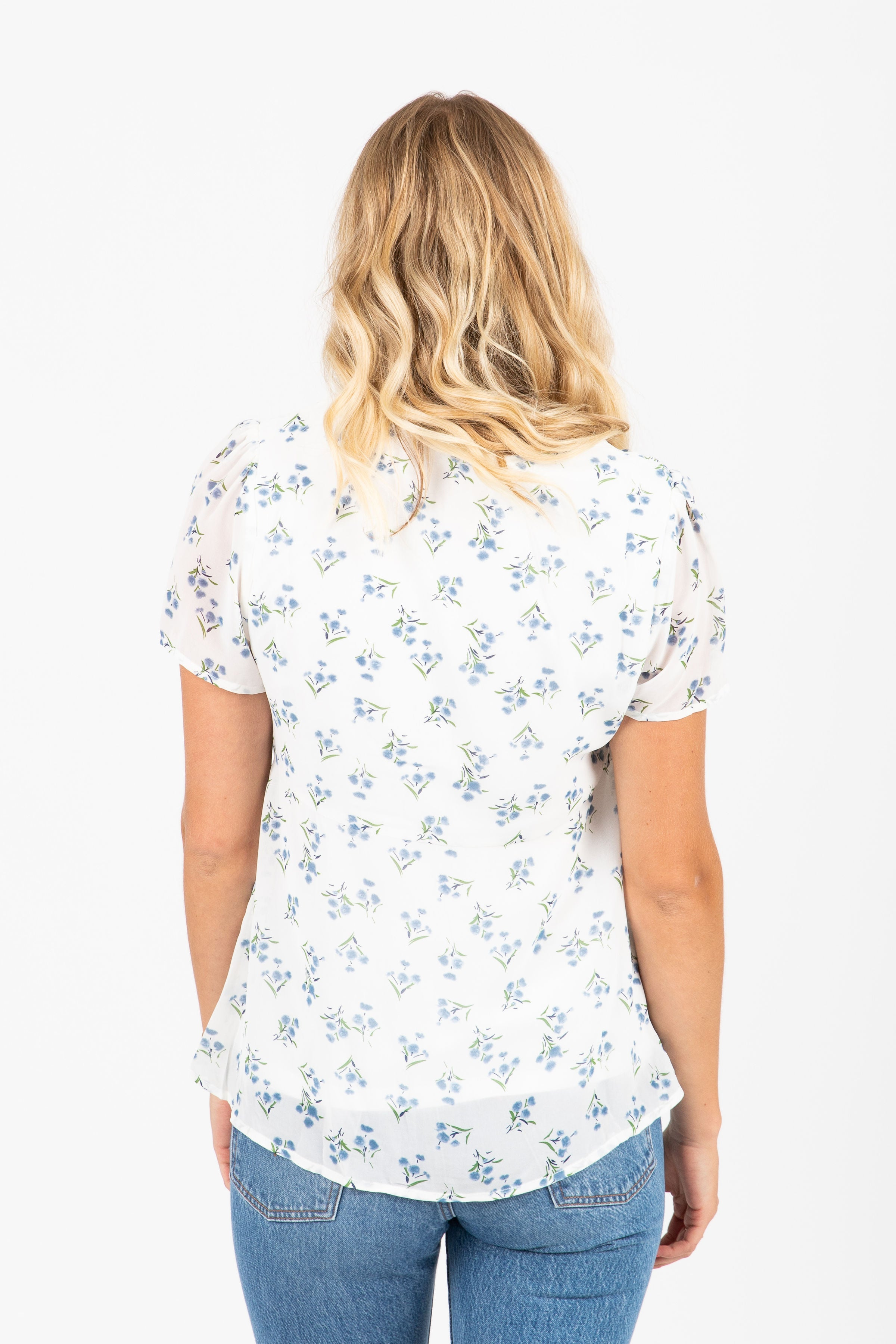 The Gallop Floral Twist Blouse in White