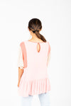 The Miranda Patterned Peplum in Rose, studio shoot; back view