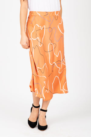 The Keilani Patterned Satin Skirt in Peach, studio shoot; front view