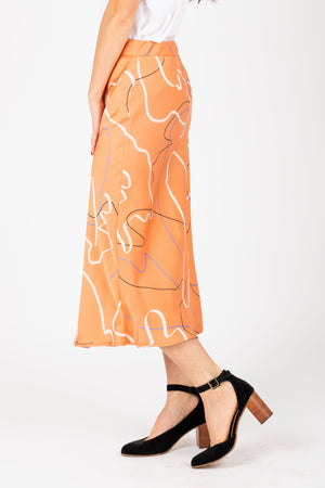 The Keilani Patterned Satin Skirt in Peach, studio shoot; side view