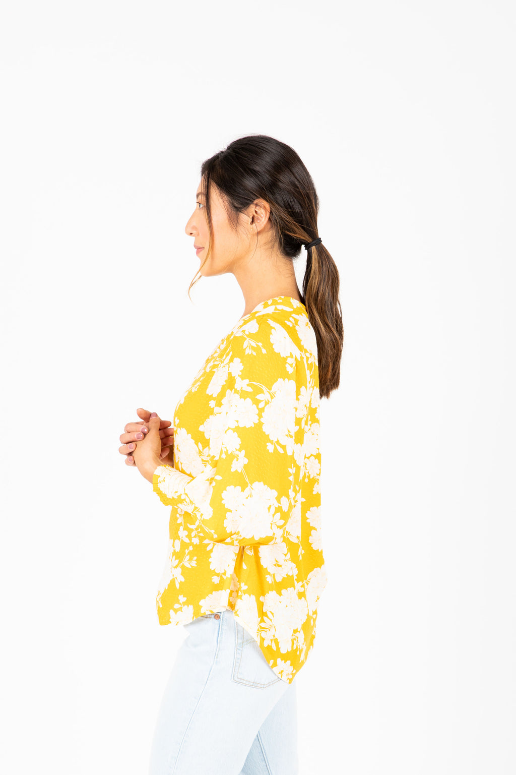 The Karson Floral Blouse in Dandelion, studio shoot; side view