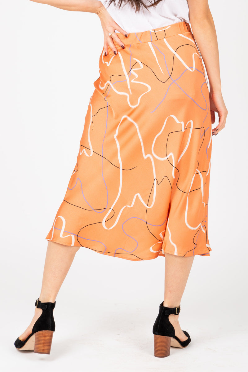 The Keilani Patterned Satin Skirt in Peach, studio shoot; back view