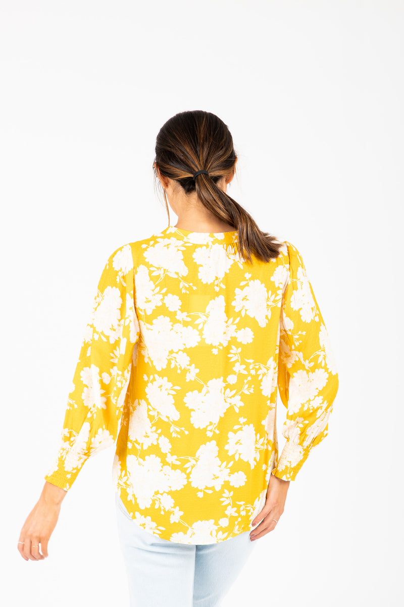The Karson Floral Blouse in Dandelion, studio shoot; back view