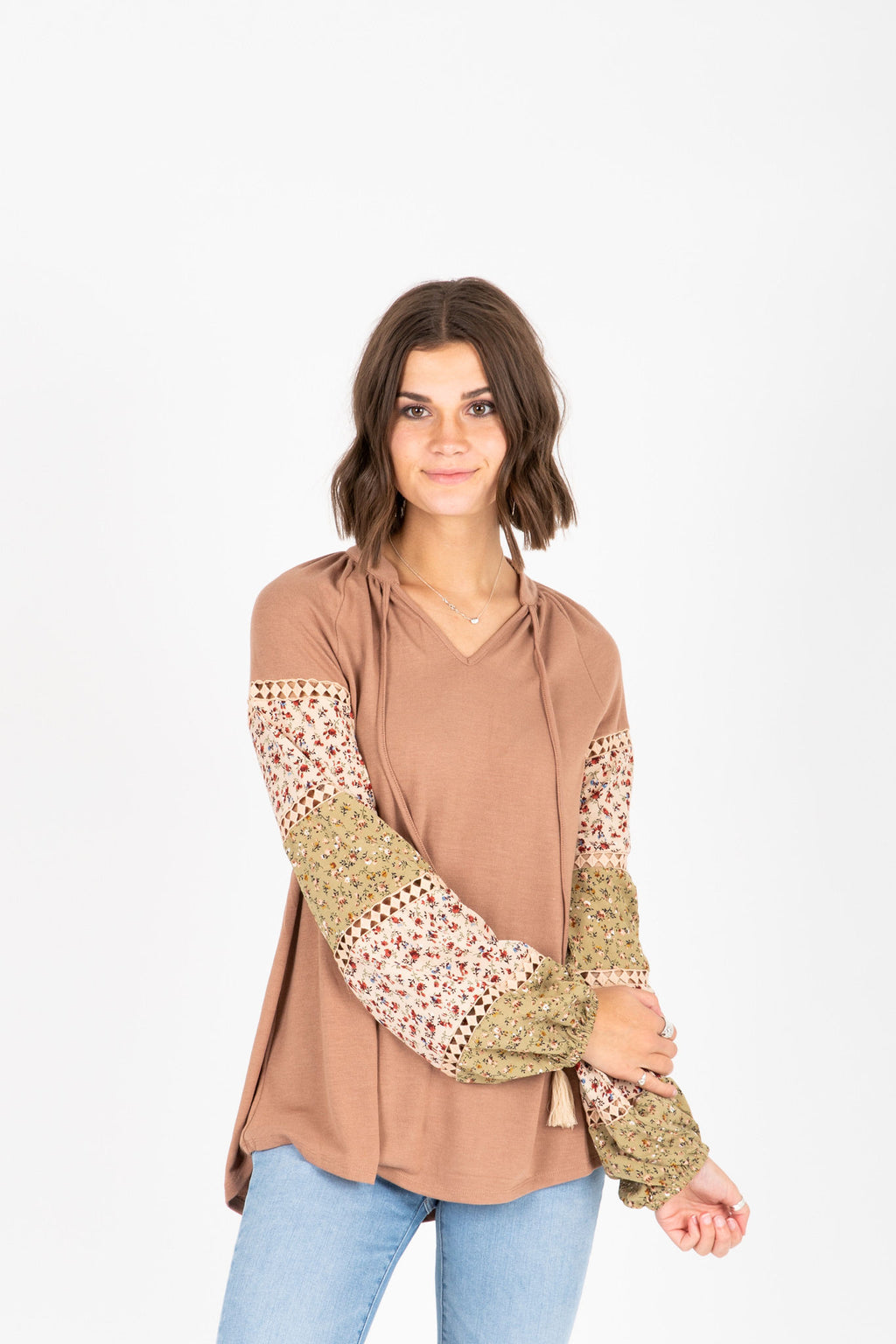 The Francia Contrast Sleeve Blouse in Blush, studio shoot; front view