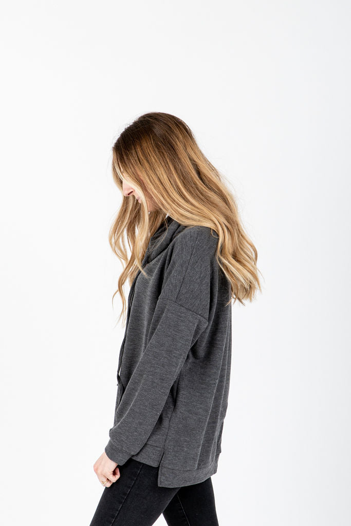 The Martyn Funnel Sweatshirt in Charcoal, studio shoot; side view