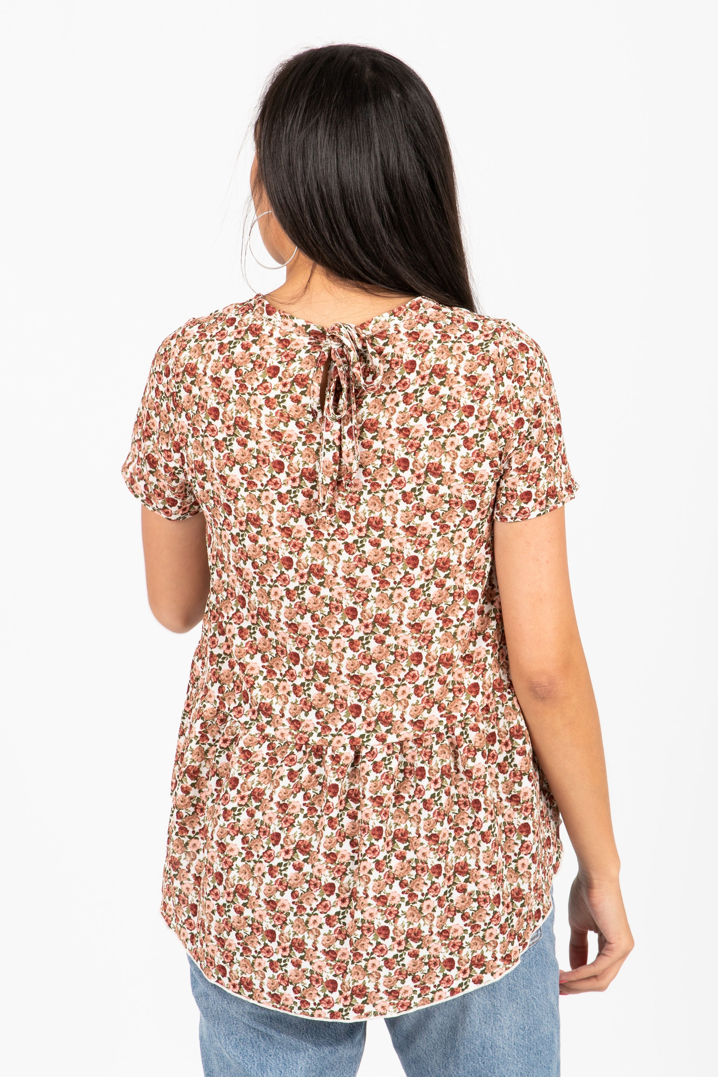 The Sphynx Floral Bow Peplum Blouse in Mauve