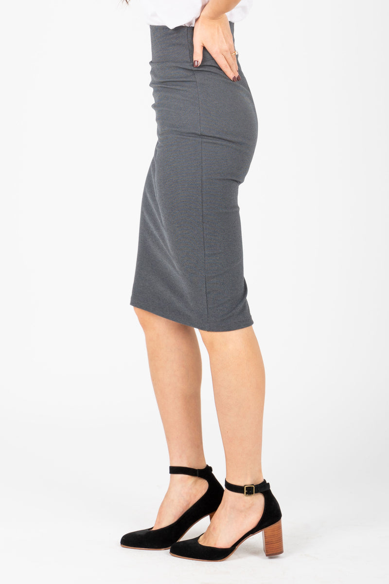 The Ponte Pencil Skirt in Charcoal, studio shoot; side view