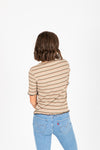 The Anna Striped Mock Neck Blouse in Olive, studio shoot; back view