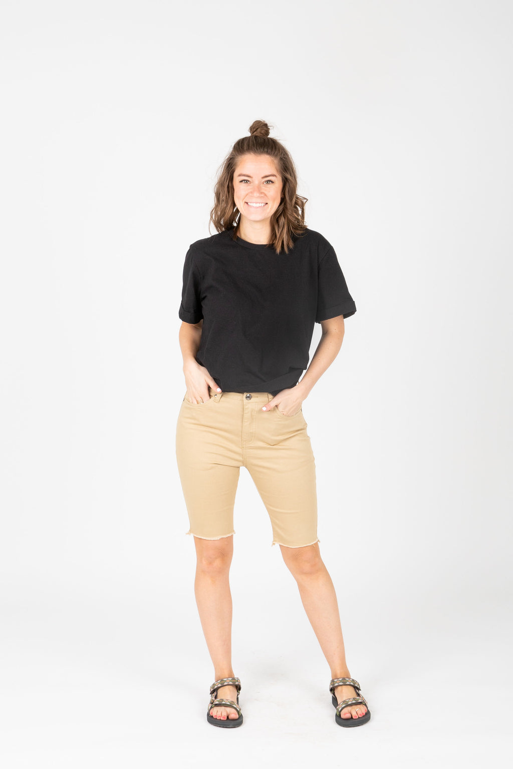 The Stretch Denim Biker Short in Khaki, studio shoot; front view