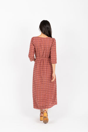 The Vivid Check Tiered Maxi Dress in Mauve, studio shoot; back view