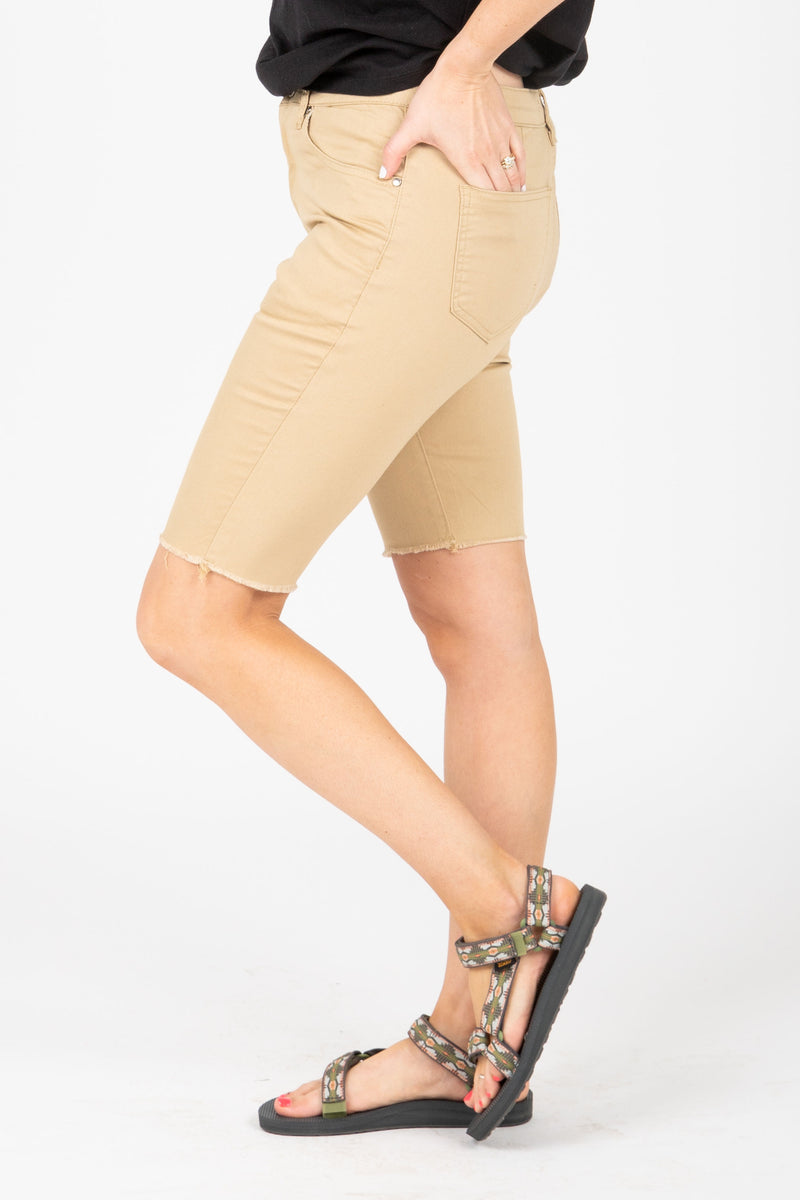 The Stretch Denim Biker Short in Khaki, studio shoot; side view