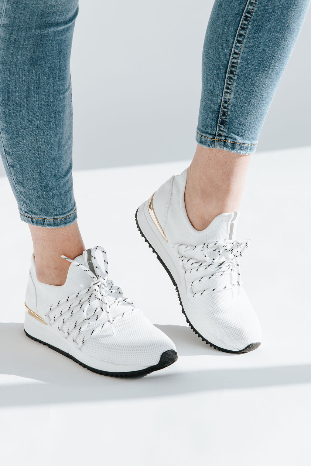 J-Slides: Mara Knit Sneaker in White, studio shoot; side view